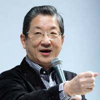 Nissan vice chairman Toshiyuki Shiga, who is also chairman of the Innovation Network Corp. of Japan, speaks during an event at the Tokyo Motor Show in 2011. | BLOOMBERG