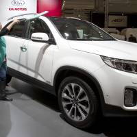 A worker polishes a new Kia Sorrento during the 2013cBrussels Motor Show at the Expo Center in Brussels. Kia is recalling more than 377,000 Sorento SUVs because the transmission can be shifted out of park when the driver's foot isn't on the brake. The recall covers Sorentos from the 2011 through 2013 model years. | AP