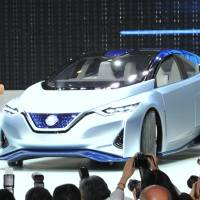 Nissan CEO Carlos Ghosn unveils its IDS Concept car at the Tokyo Motor Show on Wednesday. Autonomous driving is at the core of the IDS vision.
