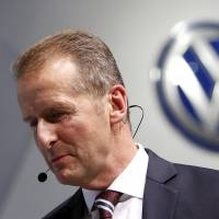 Volkswagen Chief Executive Herbert Diess leaves a presentation at the 44th Tokyo Motor Show on Wednesday. | REUTERS