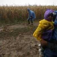 Balkan chill sets in as ill-prepared refugees from warm climes shiver in despair