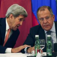 U.S. Secretary of State John Kerry speaks to Russian Foreign Minister Sergey Lavrov before a meeting in Vienna on Friday. | REUTERS