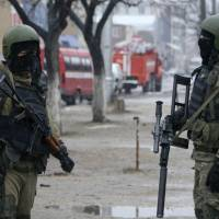 Russian special force soldiers wear masks during an anti-terrorist operation in January 2014 in Makhachkala, regional capital of Dagestan, Russia. The Russian province of Dagestan, a flashpoint for Islamic violence in the North Caucasus, is feeding hundreds of fighters to the Islamic State in Syria, officials say, and now some are coming back home with experience gained from the battlefield. | ABDULA MAGOMEDOV / NEWSTEAM VIA AP, FILE / AP