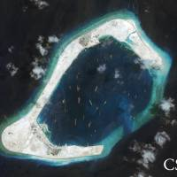 U.S. Navy's foray into China-claimed seas reportedly followed foot-dragging by White House