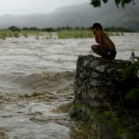 Philippine storm weakens after killing at least nine