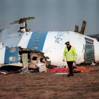 A file picture taken in Lockerbie on December 22, 1988, shows the wreckage of Pan Am Flight 103, which exploded killing all 259 people aboard. Scottish prosecutors on Thursday said they had identified two new Libyan suspects in the bombing of the Pan Am jet. | AFP-JIJI