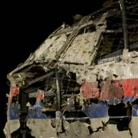 Tjibbe Joustra, head of the Dutch Safety Board, presents the board's final report into what caused Malaysia Airlines Flight MH17, seen reconstructed rear, to break up high over eastern Ukraine last year, killing all 298 people on board, during a news conference in Gilze-Rijen, the Netherlands, on Tuesday. | AP