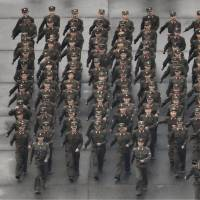 Soldiers march in Pyongyang on Saturday before the start of a parade celebrating the 70th anniversary of the founding of the ruling Workers' Party of Korea. | KYODO