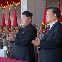 North Korean leader Kim Jong Un and Liu Yunshan, China's Communist Party's No. 5 leader, claps during a ceremony marking the 70th anniversary of the country's ruling party in Pyongyang. | AP