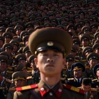 North Korean soldiers gather during a mass military parade at Kim Il Sung Square in Pyongyang on Saturday as the country marked the 70th anniversary of its ruling Workers' Party. | AFP-JIJI