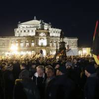 Protestors gather in front of the Semperoper, Dresden's famous opera house, during a demonstration of PEGIDA (Patriotic Europeans against the Islamization of the West) in Dresden, Germany, Monday. | AP