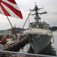 The USS Lassen is docked in May 2014 in Yokosuka, Kanagawa Prefecture. The U.S. Navy is preparing to sail  Lassen near artificial islands built by China in the South China Sea in a long-anticipated challenge to what it considers Beijing's 'excessive claim' of sovereignty in those waters, two U.S. officials said Monday. | AP