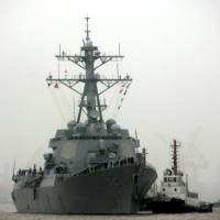 The guided missile destroyer USS Lassen arrives in Shanghai for a scheduled port visit in April 2008. | AP