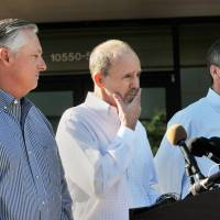 Phil Greene (left), president and CEO TOTE Services, Tim Nolan (right), president of TOTE Maritime Puerto Rico, listen as Anthony Chiarello, President | WILL DICKEY/THE FLORIDA TIMES-UNION VIA AP