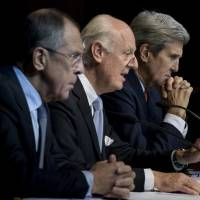 Russian Foreign Minister Sergey Lavrov and U.S. Secretary of State John Kerry listen as Staffan de Mistura, the U.N.'s special envoy for Syria, speaks during a news conference in Vienna on Friday. | REUTERS