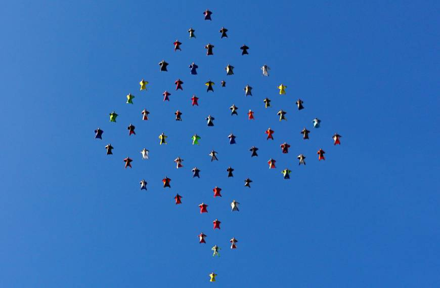61 wing suit skydivers fly into record books with California formation