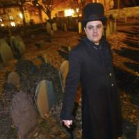 Christian Day poses in the Old Burying Ground in Salem, Massachusetts in 2003. A judge is scheduled to hear a suit on Wednesday in Salem District Court brought by Lori Sforza, who calls herself a witch priestess, accusing Day, a self-proclaimed warlock, of harassing her online and over the phone for three years. | AP