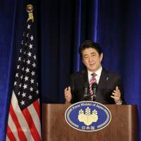 Prime Minister Shinzo Abe addresses a news conference in New York on Sept. 29. | AP
