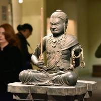 A statue by the sculptor Kaikei of the Buddhist deity known as Fudo Myoo is shown during a preview at New York's Metropolitan Museum of Art on Monday. | KYODO