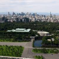 The Imperial Palace grounds are seen against a backdrop of high-rises in Tokyo's Chiyoda Ward on Sept. 30. | SATOKO KAWASAKI