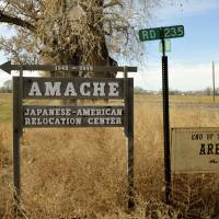 A sign points to the entrance to Camp Amache, the site of a former World War II-era Japanese-American internment camp in Granada, Colorado, in January. | AP