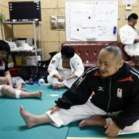 Yusuke Hatsuse (front), president of Universal Style Co., prepares for a judo training session at a university in Tokyo on Sept. 30. | BLOOMBERG