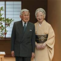 Emperor Akihito and Empress Michiko pose for a photo at the Imperial Palace in Tokyo on Sept. 29. | REUTERS