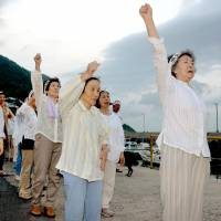 Female residents on Iwai Island, Yamaguchi Prefecture, participate in a protest over the construction of a nuclear power plant, in July 2011. | KYODO