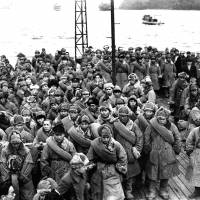 Japanese soldiers returning from Siberia, where they were imprisoned after World War II, wait to disembark from a ship at Maizuru, Kyoto Prefecture, in 1946. Japan's recent submission of files it claims are related to the POWs for inscription into UNESCO's Memory of the World register angered Russia but was accepted. | KYODO