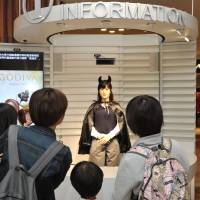 Android ChihiraJunco welcomes customers at Aqua City Odaiba commercial complex in Tokyo on Friday. | YOSHIAKI MIURA