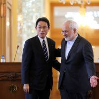 Iranian Foreign Minister Mohammad Javad Zarif and his Japanese counterpart, Fumio Kishida, are seen following their joint news conference in Tehran on Monday. | AFP-JIJI