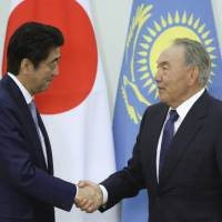 Prime Minister Shinzo Abe and Kazakhstan President Nursultan Nazarbayev meet in the Akorda presidential residence in Astana on Tuesday. | REUTERS