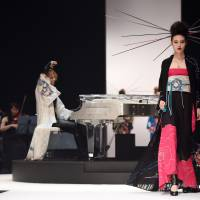 A model wears a creation by veteran musician and first-time designer Yoshiki at a Tokyo Fashion Week show on Saturday. | AFP-JIJI
