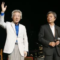 Former Prime Ministers Junichiro Koizumi and Morihiro Hosokawa appear on stage during a September 2014 rock festival in Tokyo aimed at raising public awareness of the danger of pursuing nuclear energy.