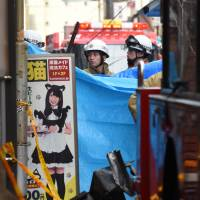 Firefighters work at the scene of a blaze that killed two customers and an employee of a maid cafe in Hiroshima's Naka Ward, on Friday morning. | KYODO