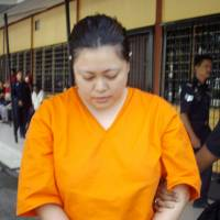 Mariko Takeuchi, whose death sentence over drug trafficking charges was confirmed by Malaysia's highest court on Thursday, is being out of a court on the outskirts of Kuala Lumpur in September 2011.   KYODO