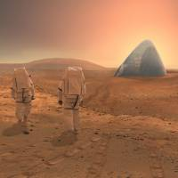 In this image, astronauts walk on the surface of Mars toward Mars Ice House, a 3-D printed multilayered igloo that won NASA's 3-D Printed Habitat Challenge in late September. | CLOUDS AO / SEARCH