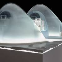 The design of the house features ice, a material indigenous to Mars that is particularly adept at shielding radiation while still allowing the passage of natural light into the habitat. | CLOUDS AO / SEARCH