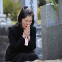 Aoki visits daughter's grave after release, wants to 'win back' 20 years in prison