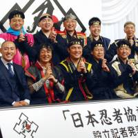 Regional government officials dressed in ninja attire pose for a photo Friday at the launch of a nationwide organization to promote ninja culture. | KYODO