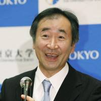 Physicist Takaaki Kajita smiles as he speaks at a news conference Tuesday evening at the University of Tokyo. | KYODO