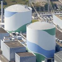 Kyushu Electric Power Co. plans to restart the No. 2 reactor (right) at its Sendai nuclear power plant. | KYODO