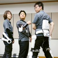 Three types of the HAL powered exoskeleton are demonstrated for a photo. The product is made by Cyberdyne Inc., of Tsukuba, Ibaraki Prefecture. | KYODO