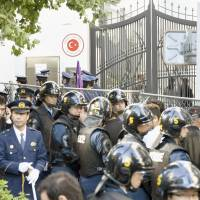 Police step up security in front of the Turkish Embassy in Tokyo on Sunday after violent clashes between Turkish and Kurds injured several people. | KYODO