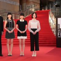 Hello Hollywood: Film director Taketoshi Sado and the members of Perfume (Kashiyuka, A-chan and Nocchi) pose on the red carpet at the Tokyo International Film Festival.