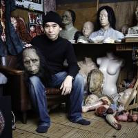 Fright night: Special effects artist Zerai Naoi sits in his studio surrounded by some of the work he has created for film and stage.   DAN SZPARA
