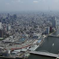 Tourist attraction: Tokyo's Tsukiji fish market (bottom left) is slated for closure on Nov. 2, 2016.   BLOOMBERG