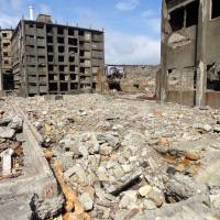 Industrial wasteland: All that is left on Gunkanjima are abandoned buildings, rubble and memories of an overcrowded bustling mining community. | TIM HORNYAK