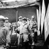 Miners express relief as they exit the Hashima Island underground mine tunnels and descend the Nyuko Sanbashi entrance stairs. | ARCHIVAL PHOTOGRAPHS USAGE AND PUBLICATION WITH PERMISSION FROM ROMAN CATHOLIC ARCHDIOCESE OF NAGASAKI