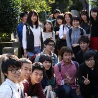 Students from Rikkyo University pose for a photo during a field trip. | KIT NAGAMURA